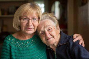 Older daugher with elderly mother
